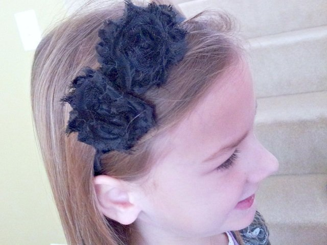 Little Miss rocking the black flower headband