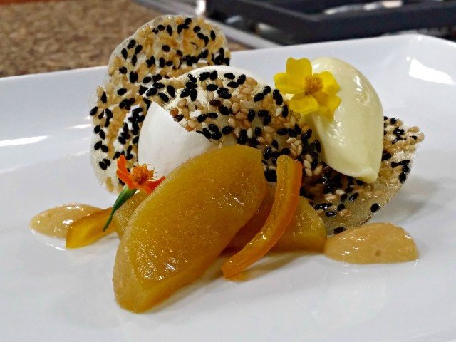 Caramel poached apples with saffron ice cream and yogurt mousse