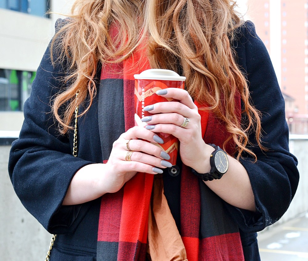 Hot drink held by fashion blogger