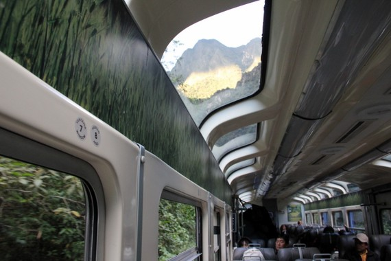 Peru Rail's panoramic windows looking out to the towering peaks