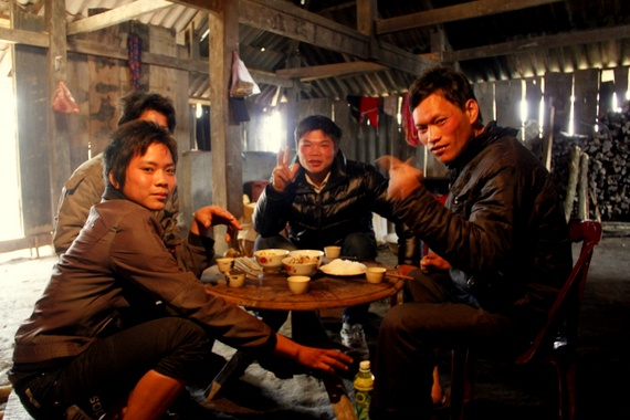 Drinking rice wine with local villagers