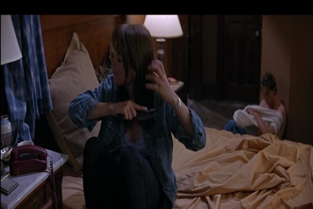 5. Sidney brushing her hair