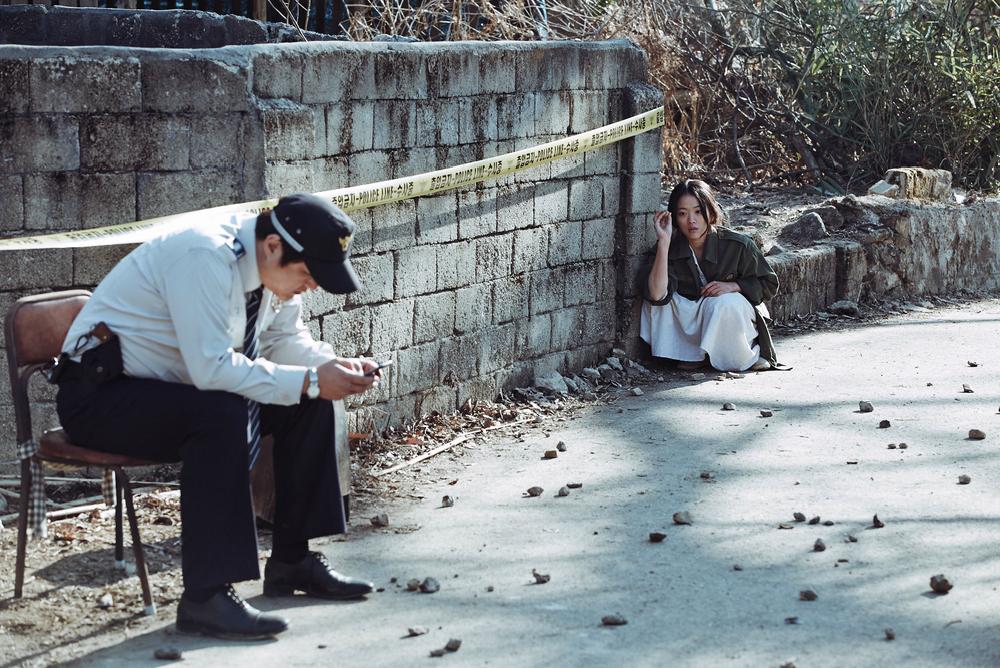 1-the-wailing-woman-throwing-rocks-at-jong-goo