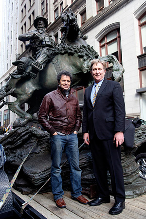 Douwe Blumberg, the artist and sculptor of the De Oppresso Liber statue, and Doug Stanton, author of the book Horse Soldiers, stand in front of the 18-foot bronze statue before the start of the New York City Veterans Day Parade. © Spec. Kerry Otjen