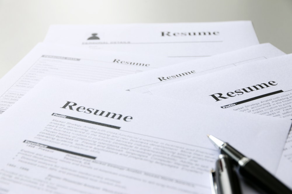 A pile of housekeeping resumes Household Staffing International