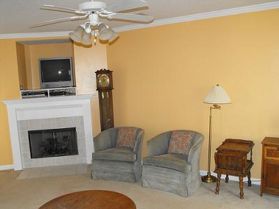 A Shade of Yellow Tan Paint on Our Living Room Walls - yellow living room walls