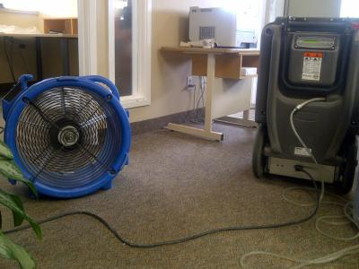 Industrial Fans And A De Humidifier To Dry Up The Water