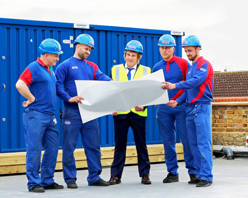 (From left to right) Craig Bly, Marcis Kravalis, Charlie Mullins, Perry Hovey and James Webb on the roof of Pimlico House, which will soon feature an additional storey