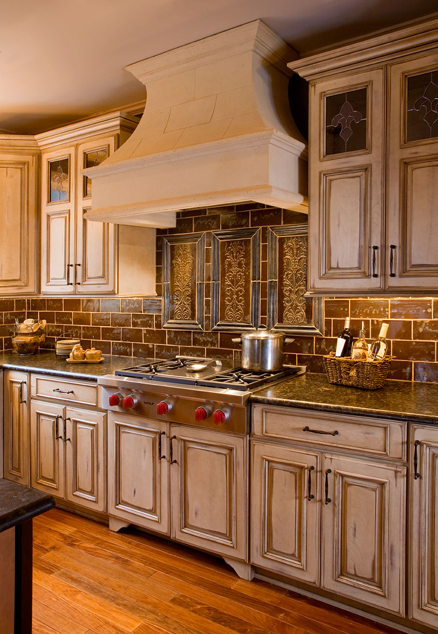 country kitchens kitchen remodeling york pa This country kitchen in New Hope PA shows off a Wolf Gourmet Series gas cooktop handmade tile plaques and backsplash limestone hood and stained glass