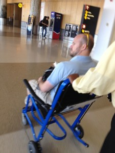 Hugh in a wheelchair at airport