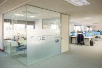 Glass Partitions With Frosted Window Film Company Logo ...