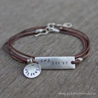 Let Go Leather Wrap Stamped Metal Bracelet