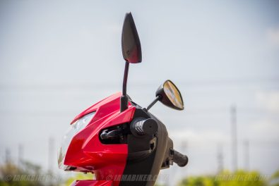 Suzuki Lets scooter headlight left view