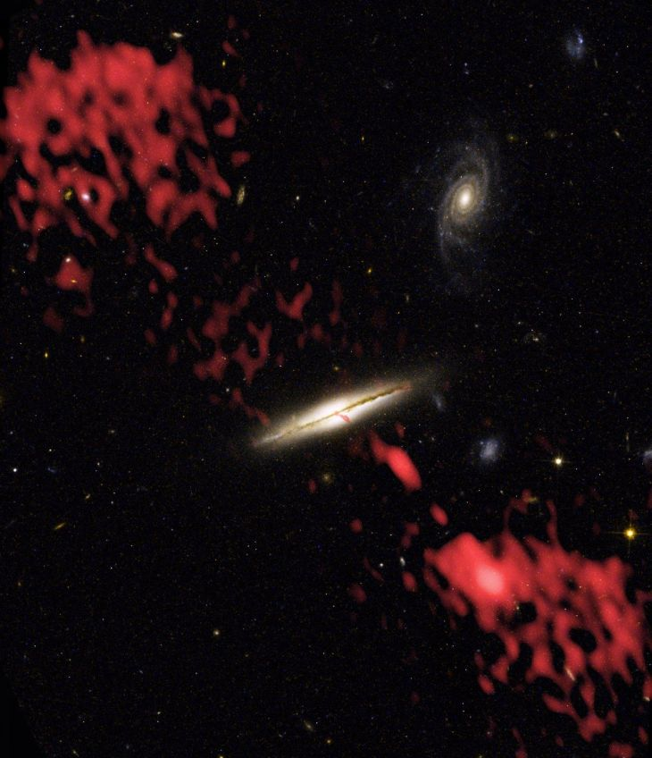 before-hubble-and-very-large-array-vla-combined-forces-to-create-this-image-astronomers-thought-that-only-elliptical-galaxies-could-produce-powerful-jets-of-subatomic-particles-like-the-jet-indicated-above-in-false-color-