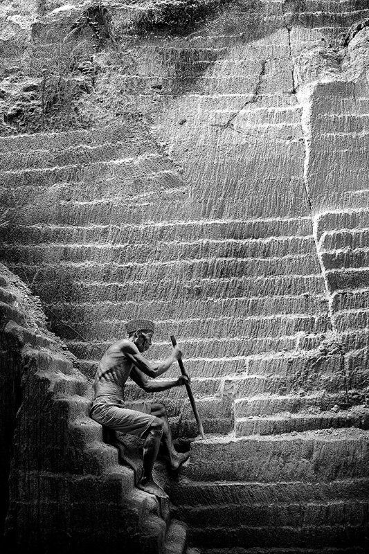 finalist-this-indonesian-man-works-on-a-limestone-mountain-in-a-small-town-he-uses-a-hammer-and-a-crowbar-to-scrape-the-limestone-to-make-brick-for-houses