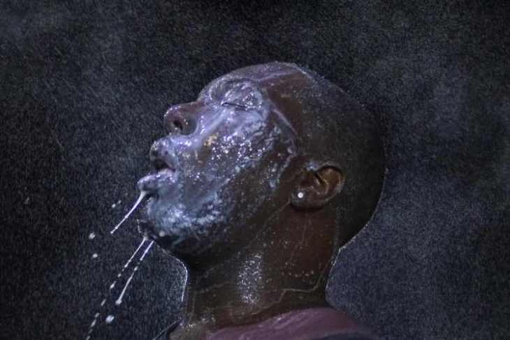 tear-gas-and-eye-irritant-was-used-liberally-on-protesters-in-ferguson-on-aug-20-this-man-doused-his-face-with-milk-to-counteract-the-effect-of-pepper-spray-which-had-been-sprayed-directly-in-his-eye-750x500