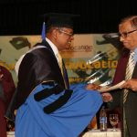 The President of the Institute of Chemistry Ceylon presenting the honorary fellowship to the Chief Guest.