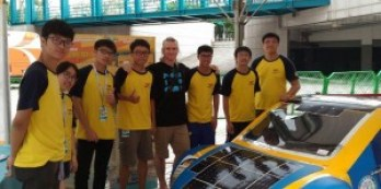 David Edward Lane poses with the Apollo Solar Car Team from National Kaohsiung University of Applied Sciences.