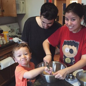 Baking cookies with his parents