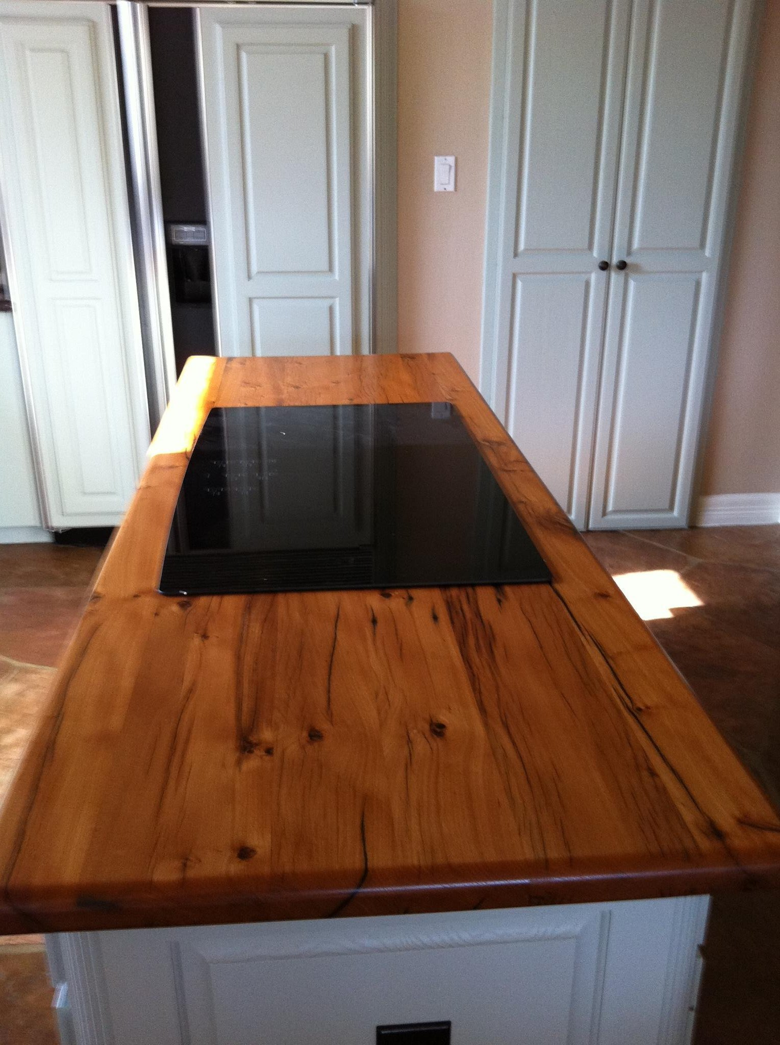 Awesome Picture for Wooden Kitchen Coutertops with Long Design and Black Glass Accent