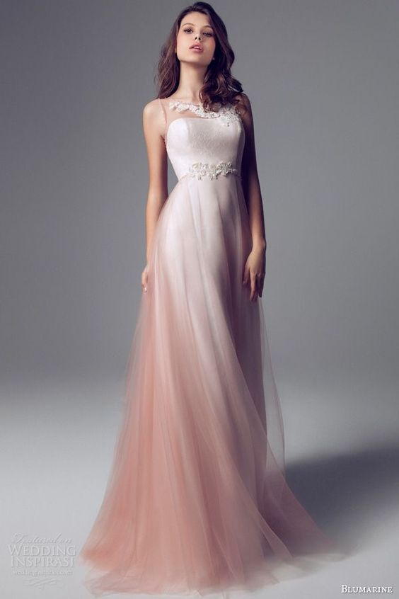 We're loving this soft and flowing, layered design, especially it's illusion neckline.