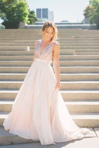 This lightly-dipped, rose gold gown has everything you need to feel like a bride again but also feel like your celebrating a milestone too.