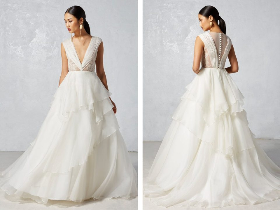 This layered piece has a lot of unique qualities but still feels very bridal and worthy of a walk down the aisle.