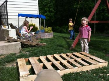 wood pallet with kids on a playground