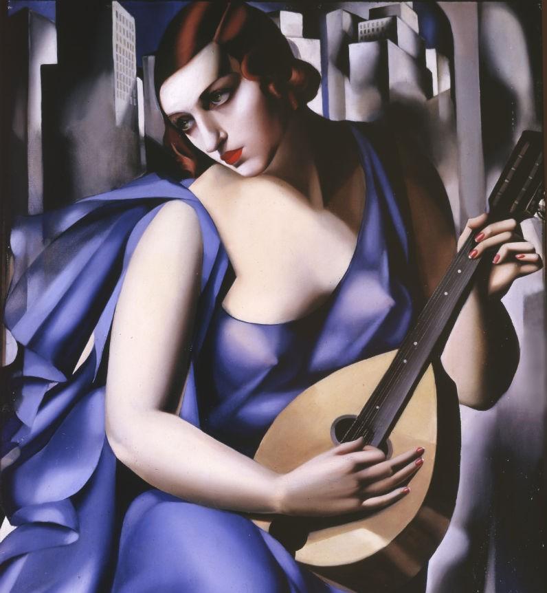 tamara-femme-bleu-a-la-guitare