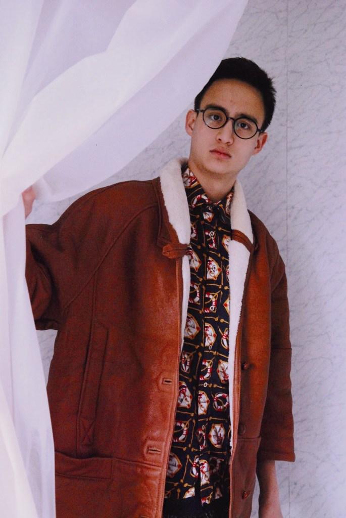 Aaron wears Shirt; Sweatpants; Jacket: model's own; Snapback: Urban Outfitters