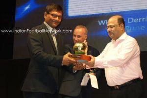 Derrick receiving the best coach award from Subrata Dutta and Joe Morrison