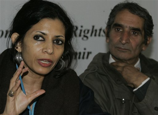 Angna Chatterji, one of the conveners of the International People's Tribunal on Human Rights and Justice, speaks as lawyer Pervez Imroz looks on during a press conference in Srinagar, India, Wednesday, Dec. 2, 2009. Human rights workers have found the graves of nearly 2,400 unidentified people scattered in cemeteries across dozens of mountainous villages in Indian Kashmir during a three year survey, the rights group said Wednesday, alleging that some of the dead were likely innocent people killed by government forces. (AP Photo/Mukhtar Khan)