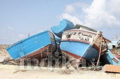 Lampedusa, scatti dal cimitero dei naufraghi e delle barche