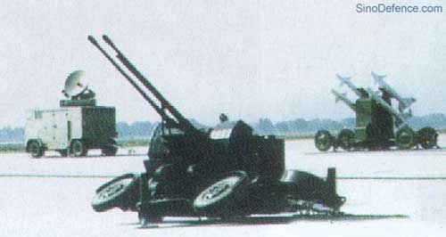 Peluncur PL-9C yang terinetgrasi dengan radar AF902 FCS dengan kanon Penangkis Serangan Udara (PSU) Twin 35 mm.