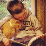 kids-reading-to-cats-ftr