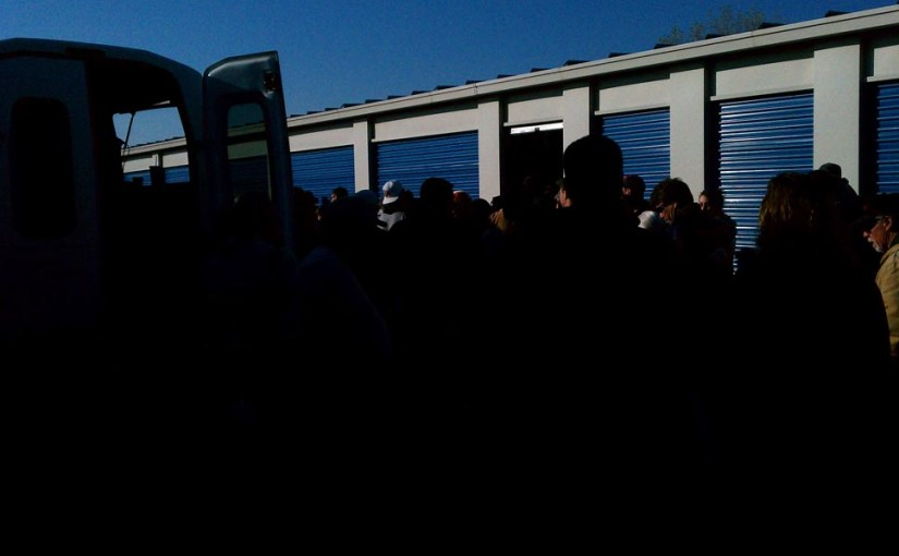 crowd at storage auction
