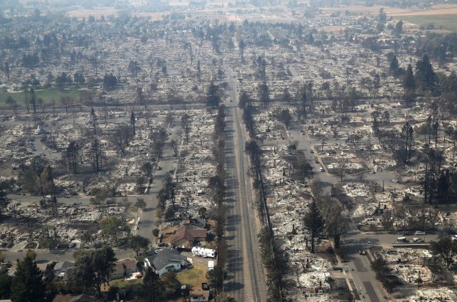 SANTA ROSA, CA - OCTOBER 11: Hundreds of homes in the Coffey Park neighborhood that were destroyed by the Tubbs Fire on October 11, 2017 in Santa Rosa, California. At least 21 people have died in wildfires that have burned tens of thousands of acres and destroyed over 3,000 homes and businesses in several Northen California counties. Justin Sullivan/Getty Images/AFP == FOR NEWSPAPERS, INTERNET, TELCOS & TELEVISION USE ONLY ==