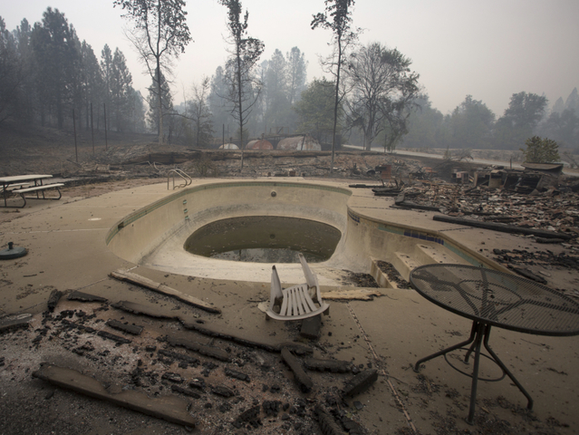 SAN ANDREAS, CA - SEPTEMBER 13: Structures around a pool lie in ruins after the Butte Fire destroyed the Golden Spur mini market north of Murphys, California on September 13, 2015 near san Andreas, California. California governor Jerry Brown has declared a state of emergency in Amador and Calaveras counties where the 100-square-mile wildfire has burned scores of structures so far and is threatening 6,400 in the historic Gold Country of the Sierra Nevada foothills. (Photo by David McNew/Getty Images)