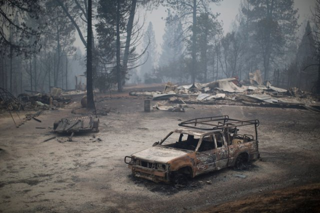 SAN ANDREAS, CA - SEPTEMBER 13: A burned truck and structures are seen at the Butte Fire on September 13, 2015 near San Andreas, California. California governor Jerry Brown has declared a state of emergency in Amador and Calaveras counties where the 100-square-mile wildfire has burned scores of structures so far and is threatening 6,400 in the historic Gold Country of the Sierra Nevada foothills. (Photo by David McNew/Getty Images)