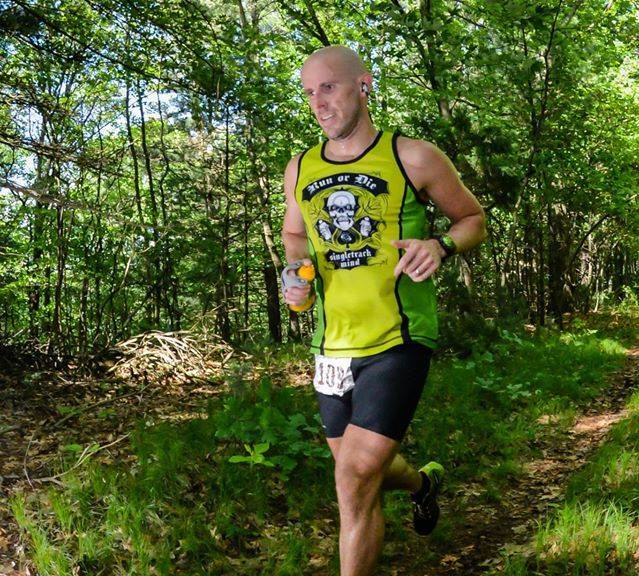 Scott wearing the Green Run or Die Tank Top and matching the trail!