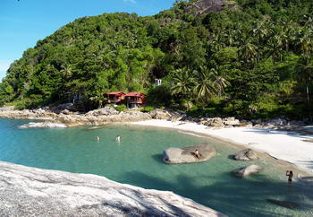 Bays of Koh Kood and swimmers - holiday in Thailand
