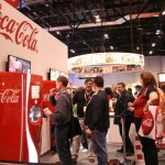 IAAPA convention goers take a pit stop for a refreshing drink at the Coca-Cola booth