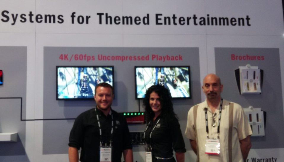 At the Alcorn McBride booth at InfoComm: Scott Harkless, Loren Barrows and David Steinberg