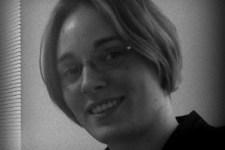 Krysha Thayer, freelance author and poet.