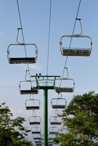 Empty sky lift chairs in the air.