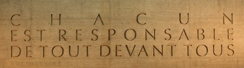 Chacun est responsable de tout devant tous - Everyone is responsible to everyone for everthing. Motto in stone of the Red Cross & Crescent, Geneva, Swizerland