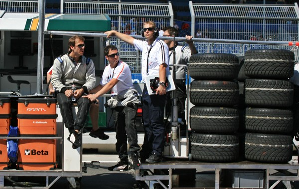 Inside the Pit Lane at the Valelncia Grand Prix - Men Sitting on Tyres
