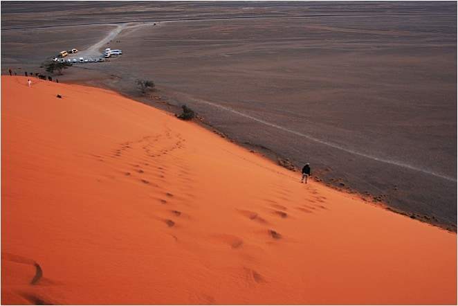 The Namib Desert must look like a cheeky little upstart, while the travelers who scramble across the sand must resemble tumbling toddlers at a kindergarten recess. It is a desert racing against the sands of time.