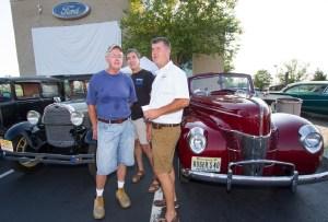 Joe Cryan, from Washington, talks with Smith Motor Company owners John and Jeff Smith.