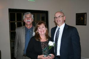One of the honorees, Su Hirshberg, receives her award from Robert Pruznick, CEO of the Art of Warren County (left) and presenter John Whitehead, Community Living Arrangements Director at the Arc.